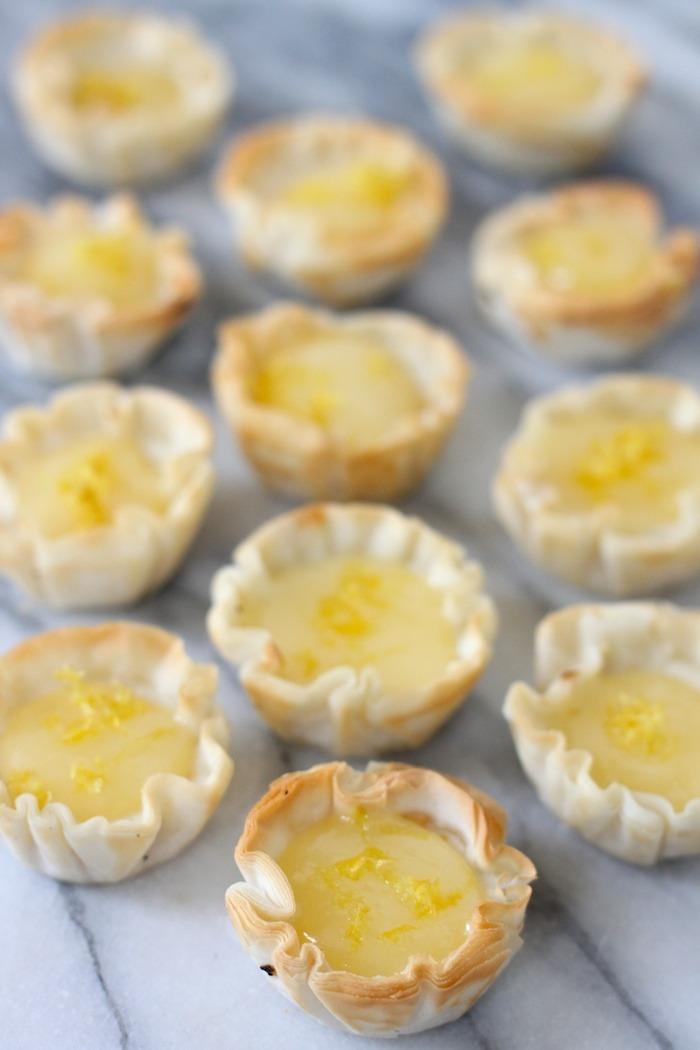 Mini Lemon Cheesecakes on marble surface