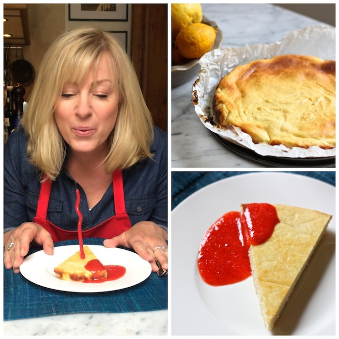 A blond woman blowing out a birthday candle on a triangular piece Lemon Ricotta Cheesecake