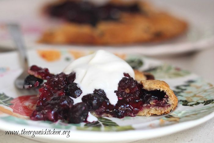 One slice od Blackberry Walnut Galette with whipped cream