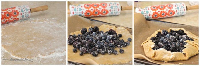 Pie crust with blackberries being folded into a galette