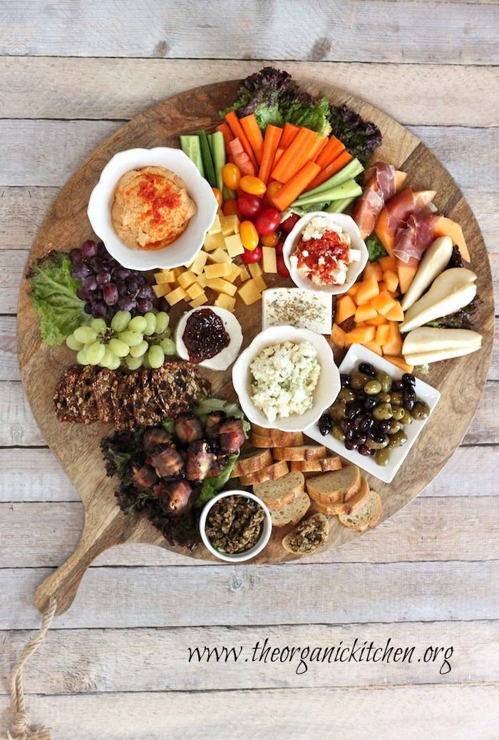 A platter of appetizers including Sun Dried Tomato Hummus