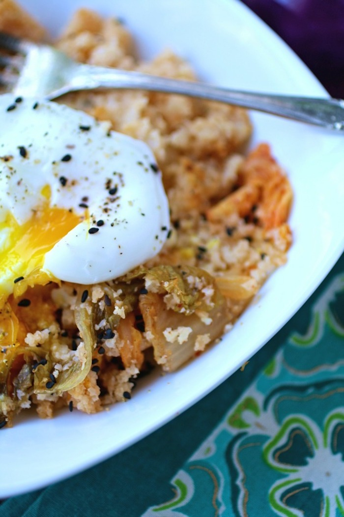 A close up of Kimchi cauliflower rice and poached egg in white bowl, one of 12 Healthy, Delicious (Whole 30) Breakfast Recipes!