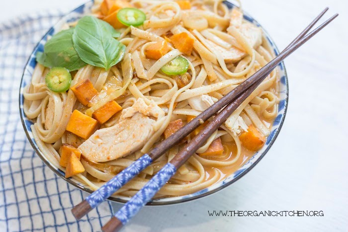 Chicken and Sweet Potato Asian Noodle Soup in blue and white bowl with chop sticks and dish towel