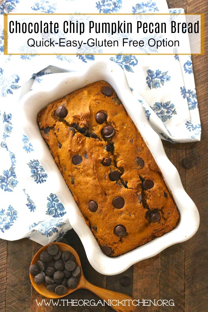 Chocolate Chip Pumpkin Pecan Bread in a white baking dish with a blue and white dish cloth