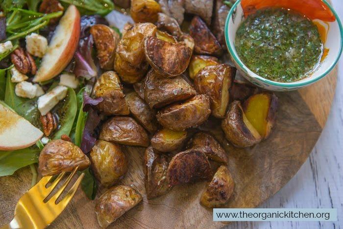 A close up of the crispy potatoes on the Chimichurri Steak, Potato and Salad Board