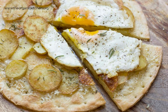 A Rosemary Potato Flatbread with Cauliflower Crust Option with a fried egg with runny yolk
