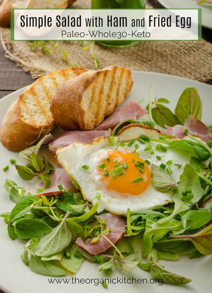 Simple Green Salad with Ham and Fried Egg on white plate