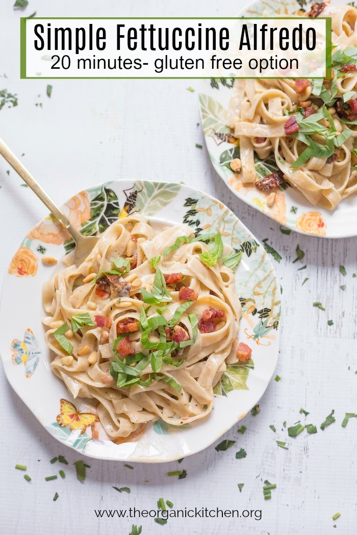 Simple Fettuccine Alfredo on a plate with gold fork