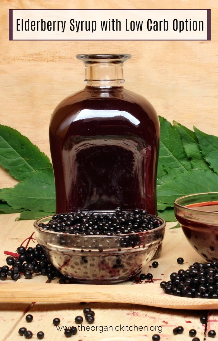 Elderberry Syrup with Low Carb Option in jar with bowl of berries in the foreground