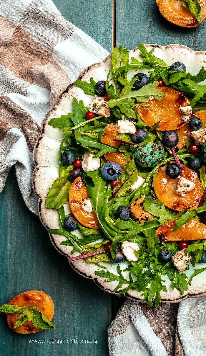 Close up of Grilled Apricot and Blueberry Salad on white plate