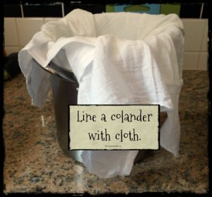 Line a colander with cloth