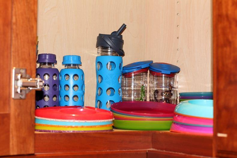 Organizing A Kitchen Cabinet With The Kids' Tableware
