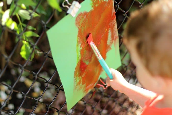 DIY Outdoor Easel For Kids - Painting With Clips On Fence