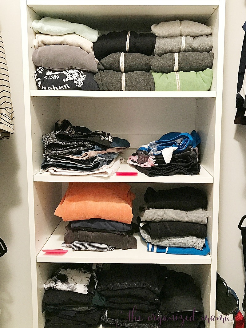 how to organize clothes on a shelf in a closet