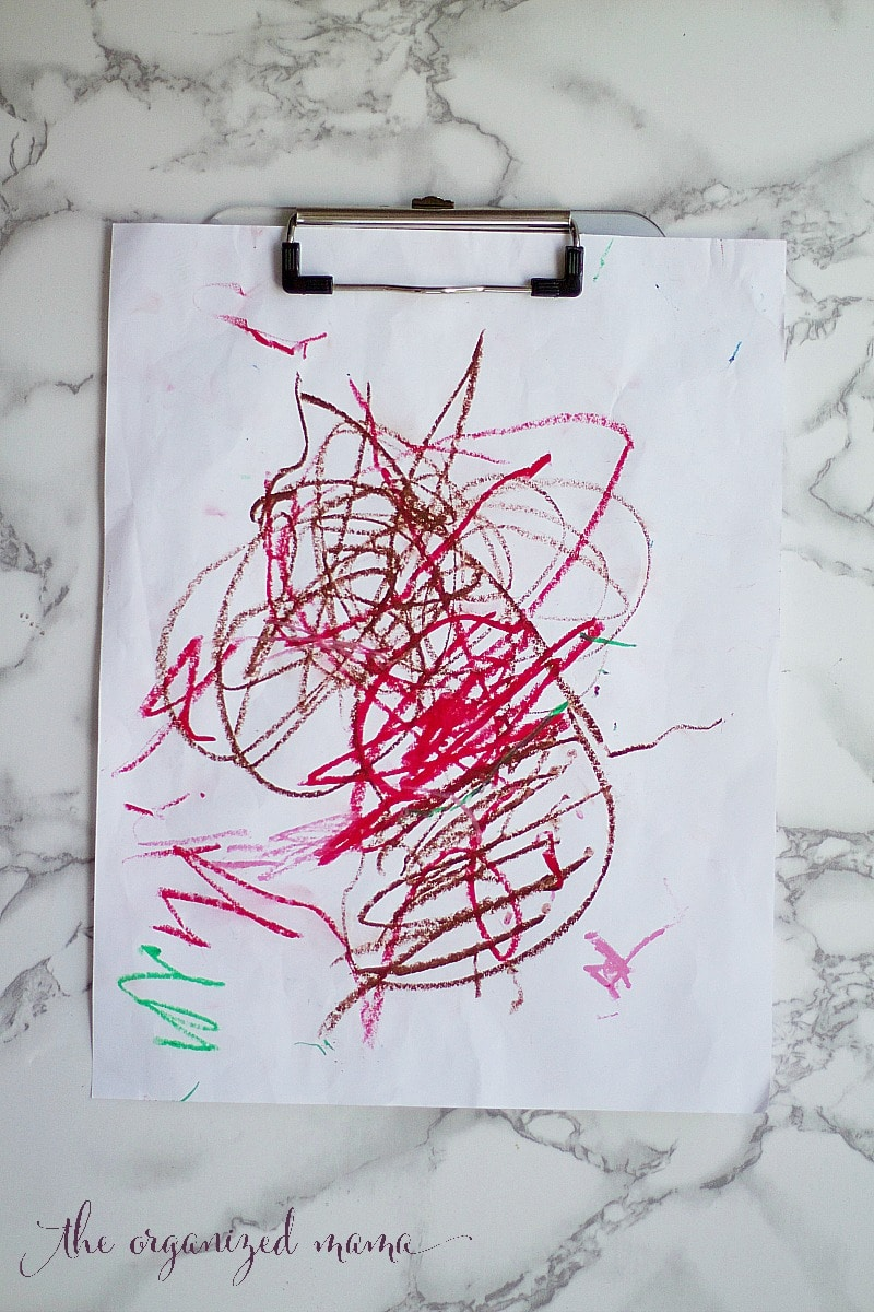 storing kids artwork with clipboards
