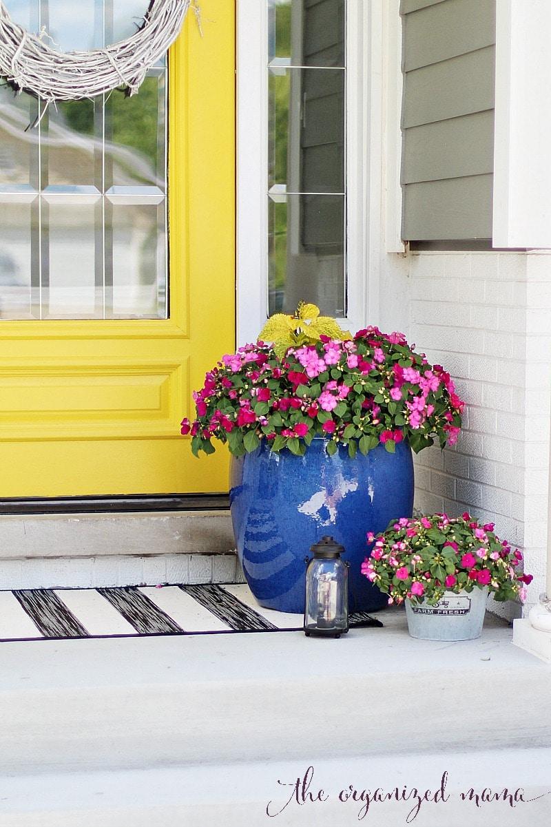 yellow door blue planter patio decorating ideas for summer
