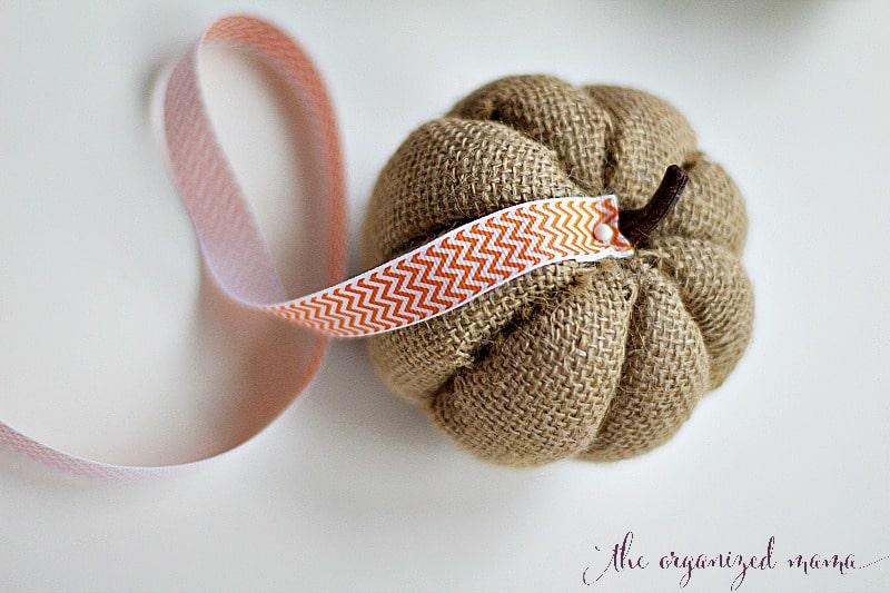 fall pumpkin DIY adding ribbon to burlap pumpkin