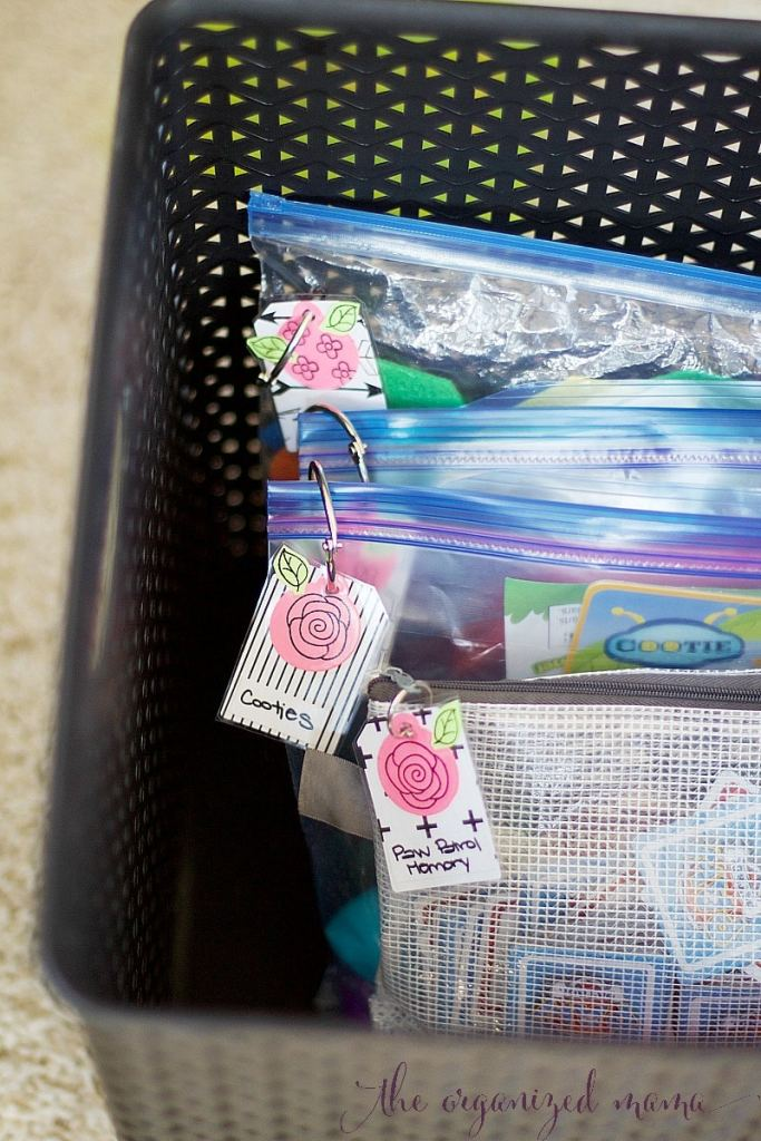 kids game storage ideas in baggies with labels
