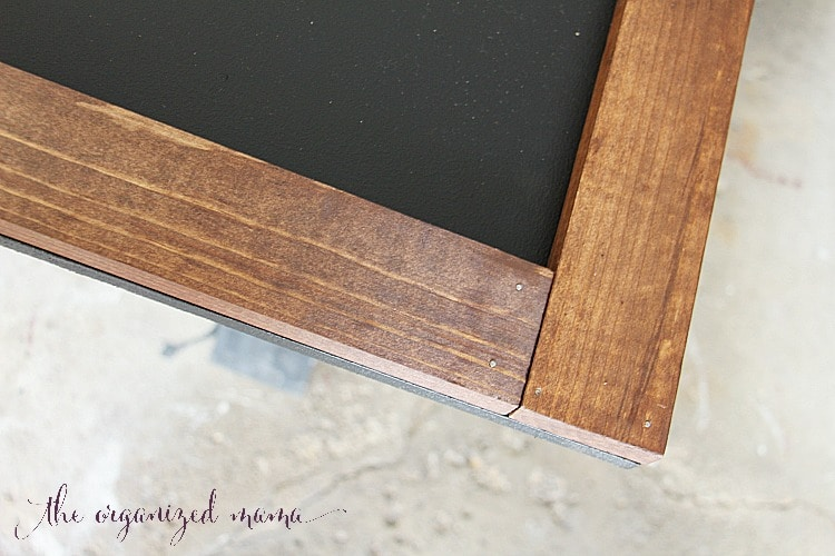 Attach the wood to the MDF using finishing nails to the simple extra large chalkboard
