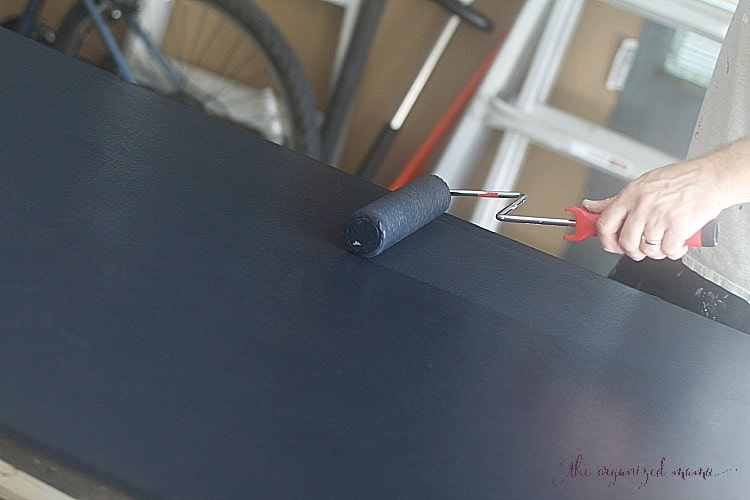 Using chalkboard paint and a roller brush to paint simple extra large chalkboard