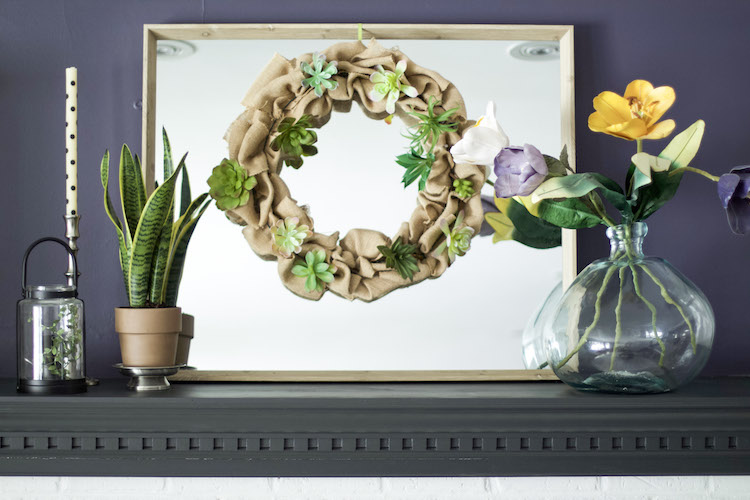 Follow this easy tutorial for creating dollar store flowers spring wreath! It makes the perfect addition to any space to add some spring into your home! #springwreath #flowers #dollarstore
