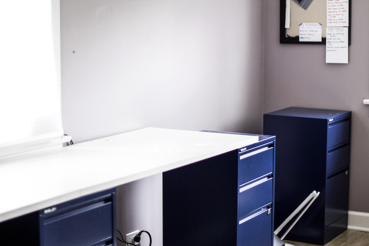 Professional Organizer, The Organized Mama, shares tips she has learned over the years for how to create desk office organization for any office space! #homeoffice #deskofficeorganization #longdesk