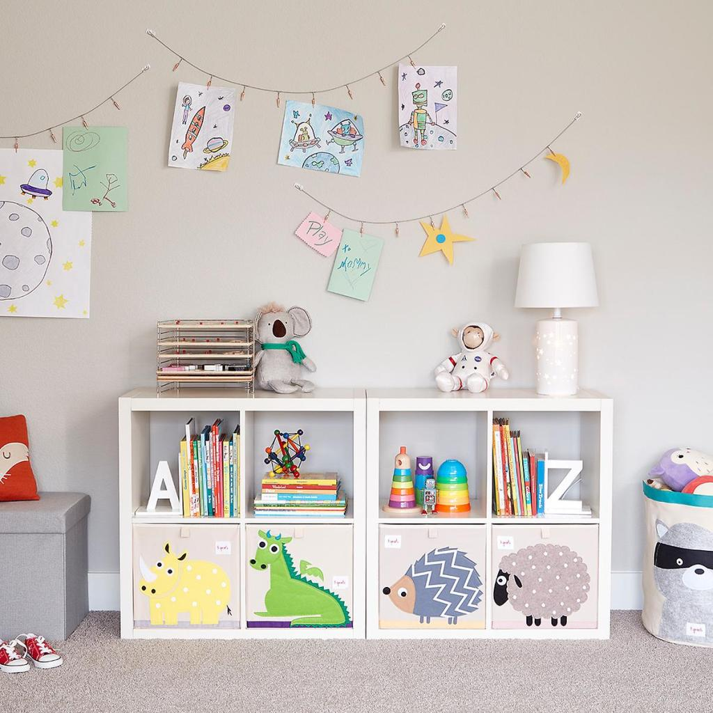 Playroom with cube organizers and wall decors in playroom #organized