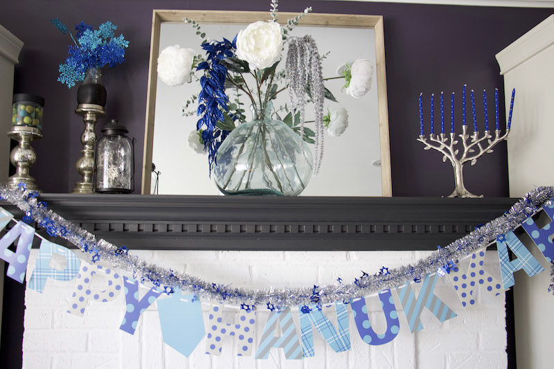 happy hanukkah banner on mantel