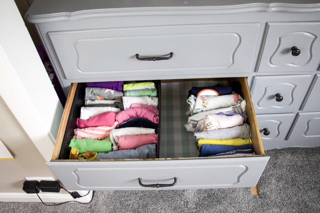 Folded clothes in a dresser drawer #organization #summer
