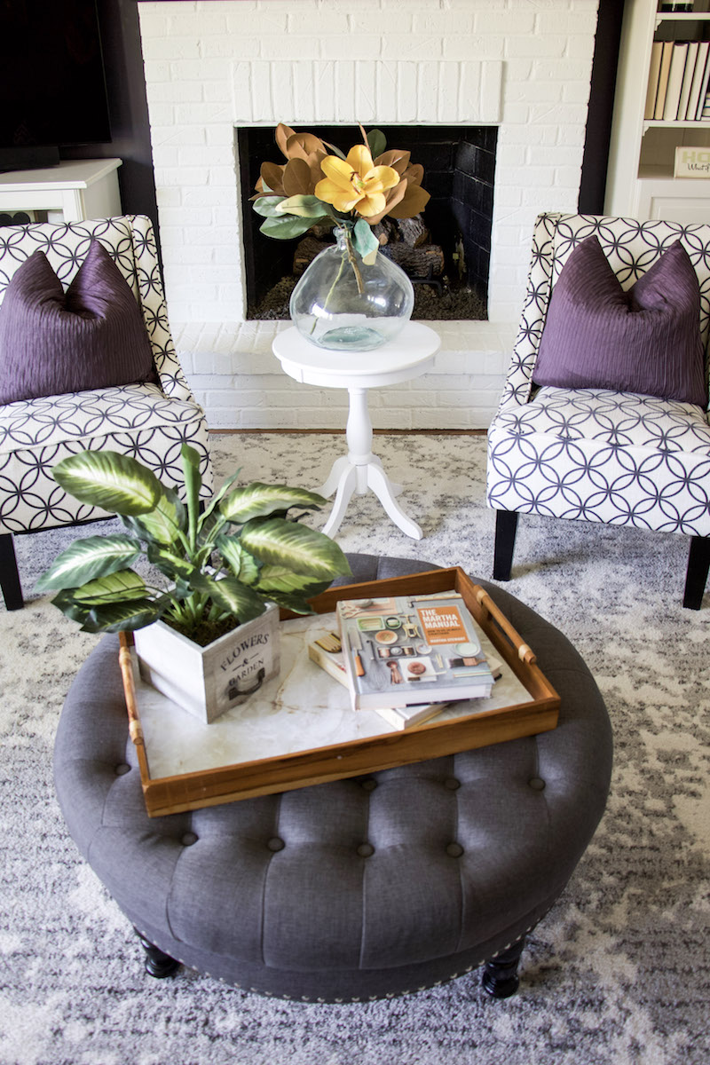 upcycle wooden tray on ottoman with two chairs behind