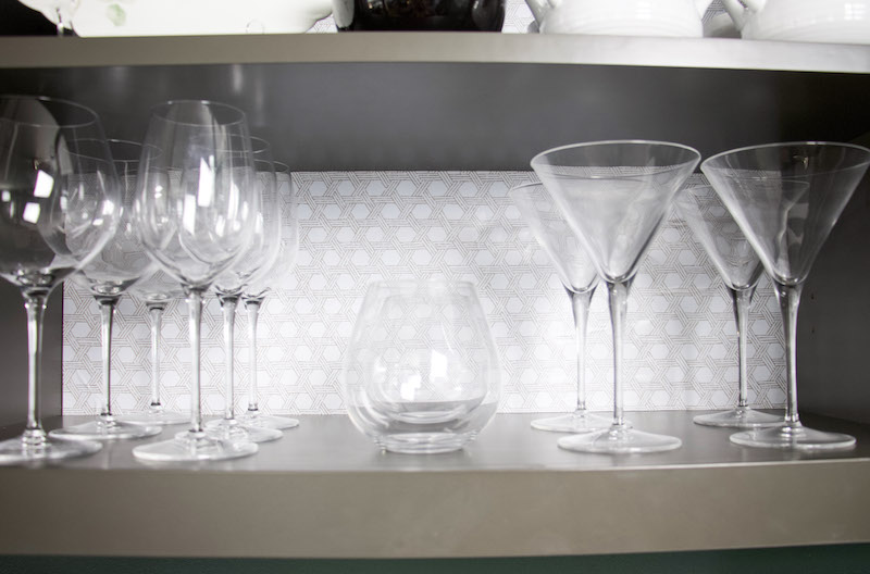 close up of basket weave pattern behind glassware