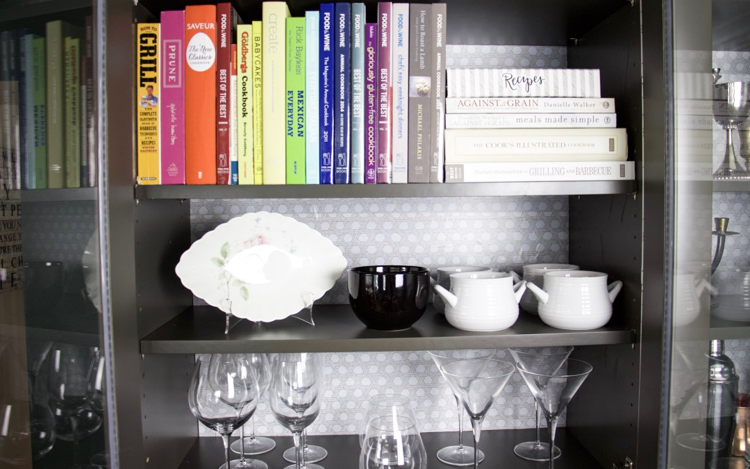how to line cabinets with easyliner with cookbooks in front and glassware in front
