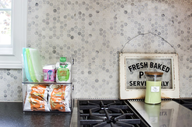setting up a snack station for kids on countertop