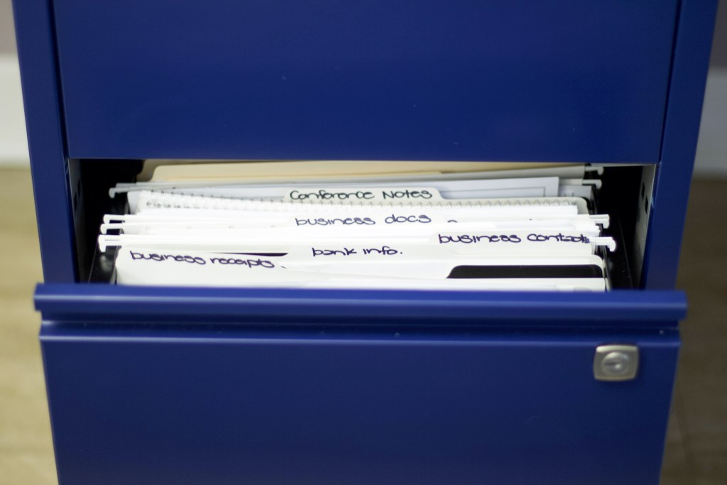 Open file cabinet to show organized paper with no clutter #declutter #organizedpaper