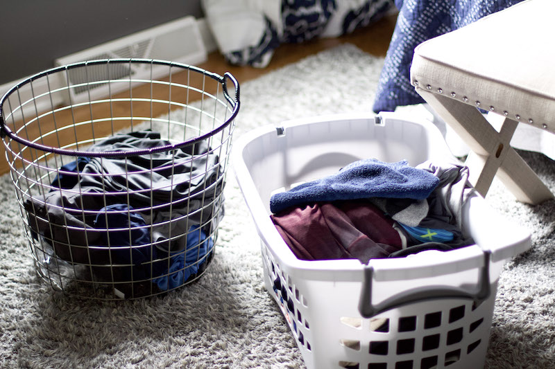 laundry in bedroom with one basket for dirty clothing and the other for clean to demonstrate laundry hacks