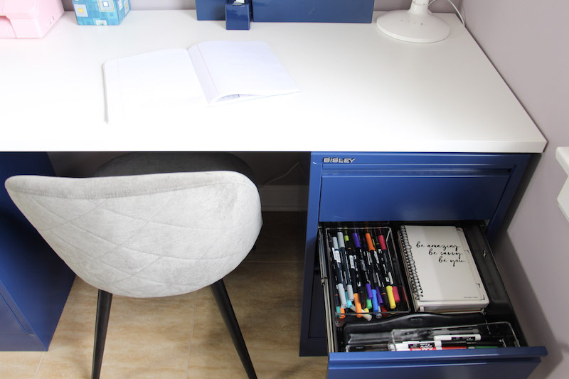 desk drawer with markers and notepads