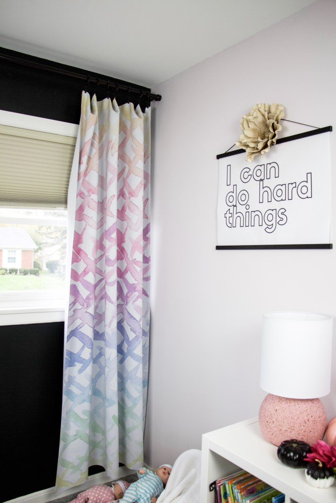 curtains and poster on wall to show how to hang things without damaging walls