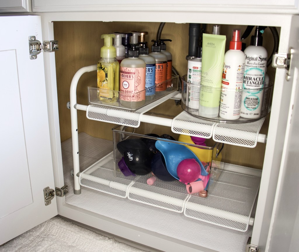 under sink expandable shelves with turntable and drawer organizers to keep things tidy