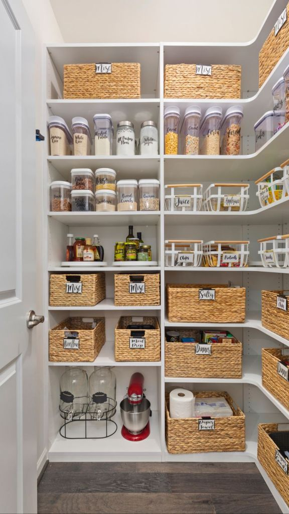 pantry with shelves and baskets and labels