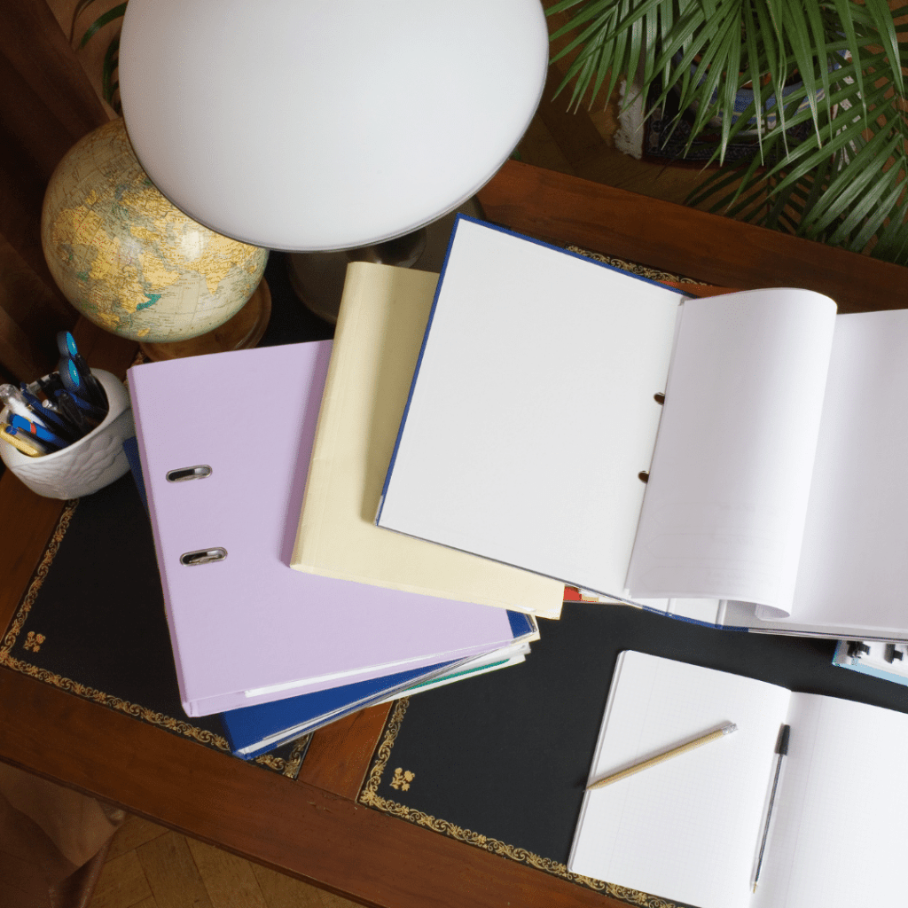 notebooks on table to showcase professional organizer client contracts