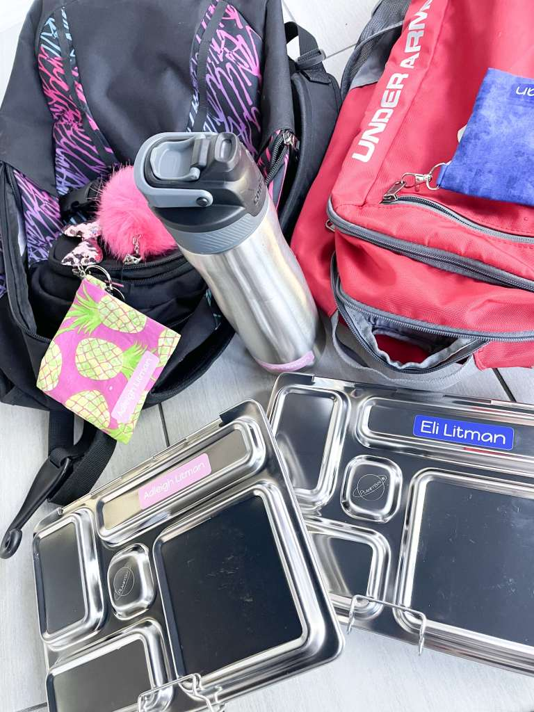 backpacks, lunch boxes, and water bottles with labels from Name Bubbles