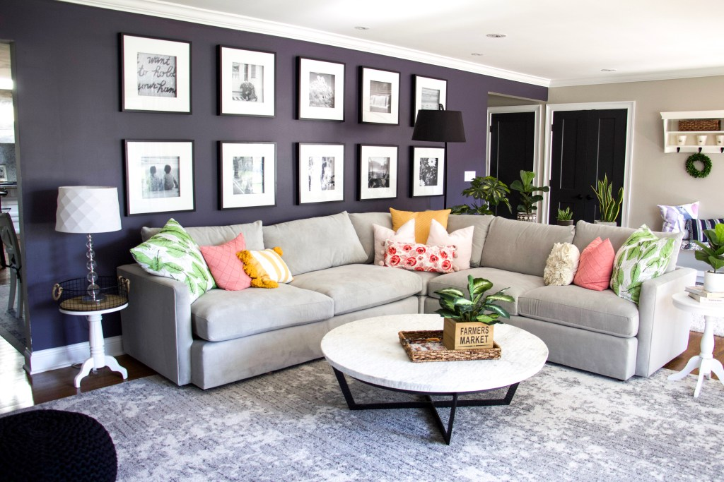 grey couch with cushions to demonstrate how to keep house clean