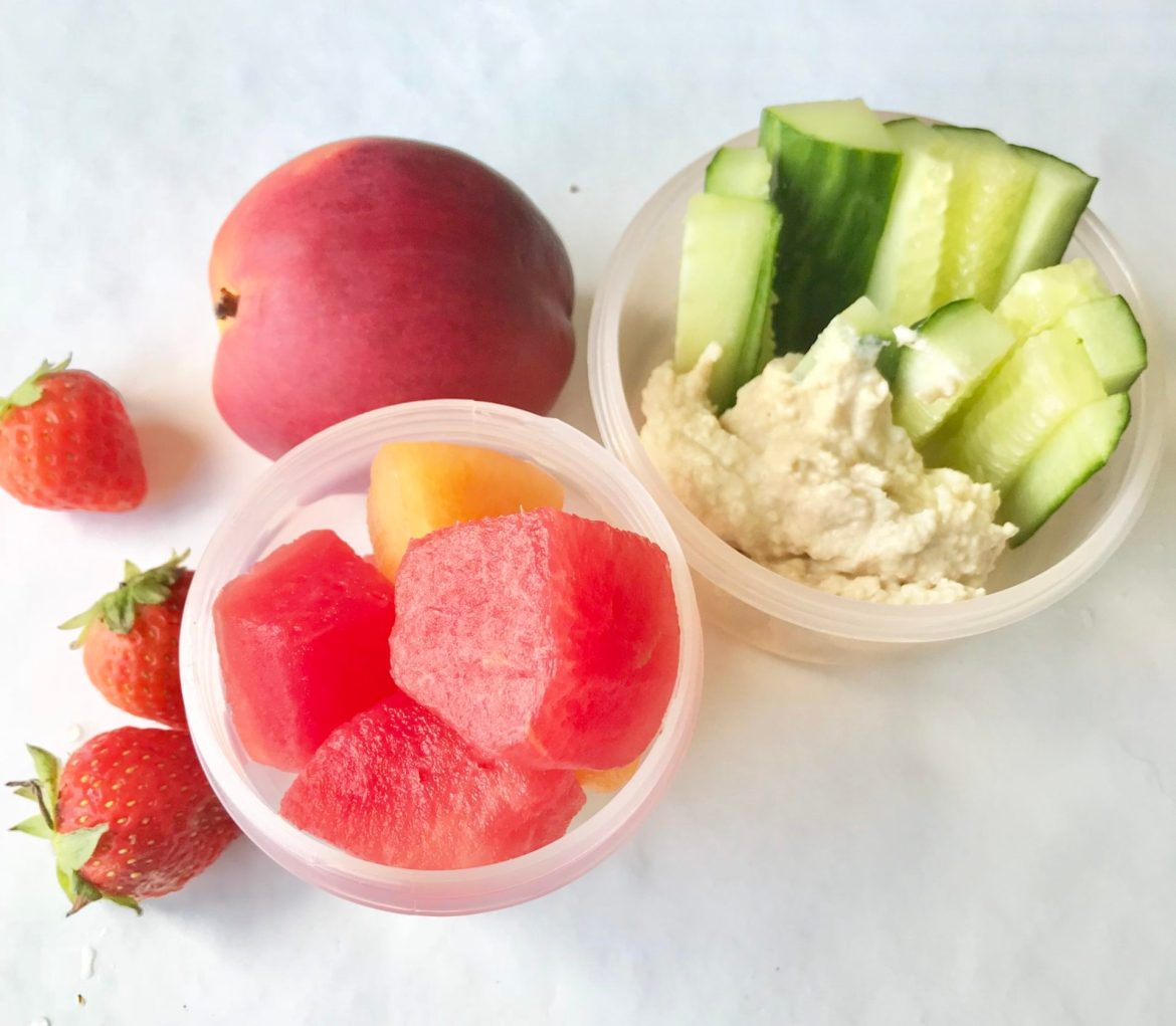 melon cucumber, humous, strawberries and a peach for healthy snackbox