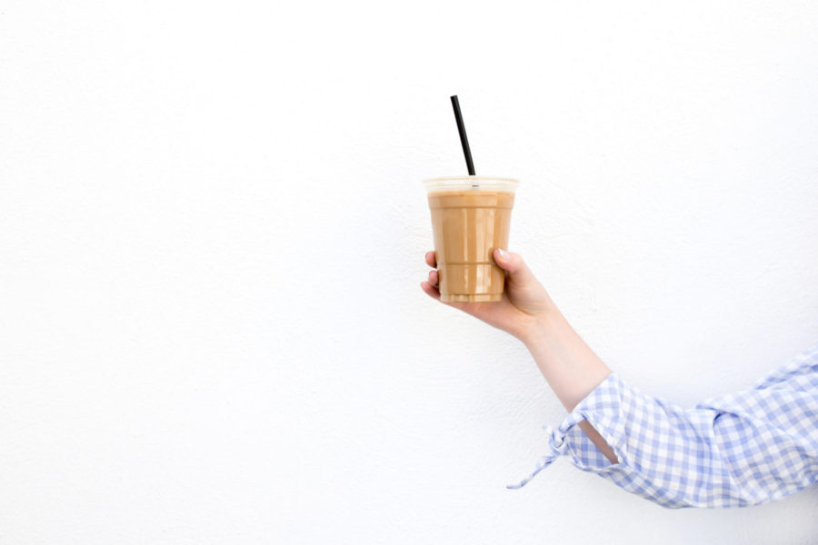how to set up a Christmas budget, lady holding a  take away frappuccino