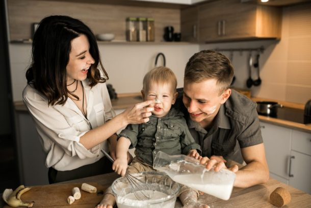 Family in the kitchen cooking - Teaching Gender Equality at Home