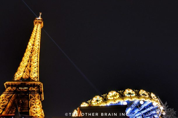 Christmas time view of Eiffel Tower and a well-lit Merry-go-round!