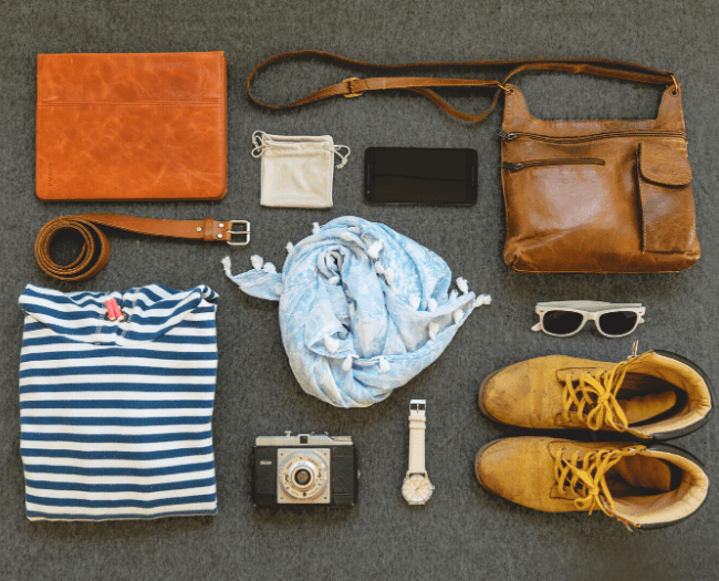 Lay down all things needed to be packed before arranging in the bag: How to Pack a Suitcase Correctly