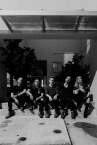 Makari band sitting in PR photograph