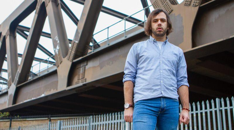 Mike Stoyanov by a bridge