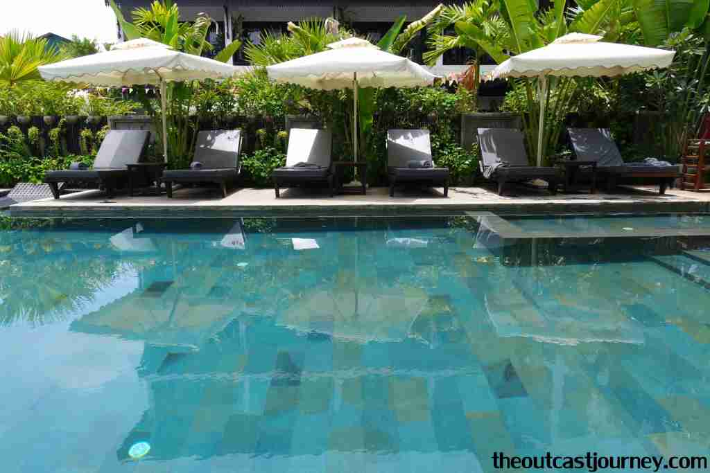 poolside in central suite residences